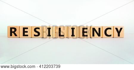 Resiliency Symbol. Word 'resiliency' Written On Wooden Blocks. Copy Space. Beautiful White Table, Wh