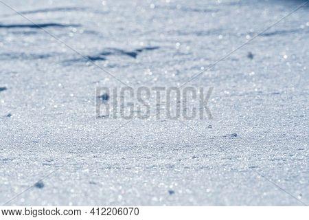 Snow Background. Lots Of Frozen Snowflakes In Daylight In Winter. Frozen Frozen Snowdrift.