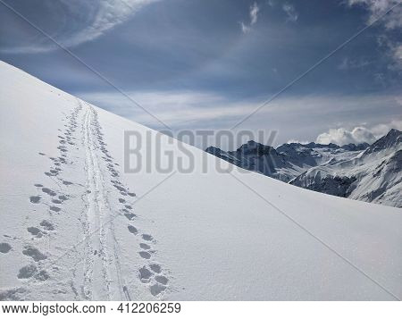 Ski Touring Track With Snowy Mountain Peak In The Background, Skimo Mountaineering In Davos Klosters