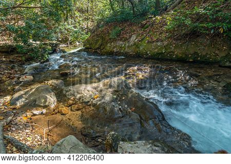 Fast Moving Water Through The Rocks And Boulders Going Downstream In The Forest In The North Georgia