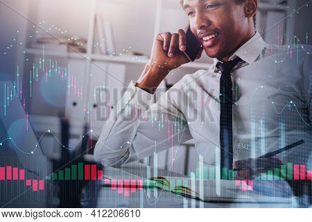 African American Business Man Or Stock Trader Analyzing Stock Graph Chart Using Laptop On Conference
