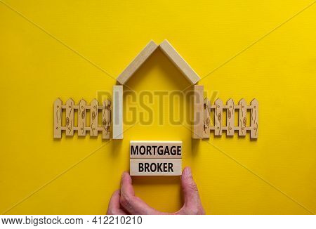 Mortgage Broker Symbol. Concept Words 'mortgage Broker' On Wooden Blocks On A Beautiful Yellow Backg