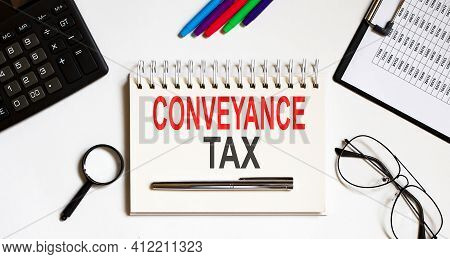 Conveyance Tax- Text On Notebook With A Pen And Office Tools