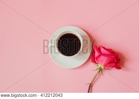 Cup Of Coffee And Pink Rose. Top View, Copy Space.