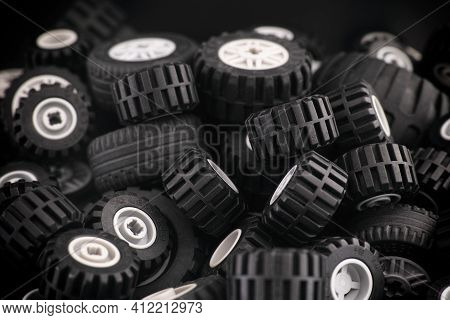 Tambov, Russian Federation - March 10, 2021 A Heap Of Lego Wheels With Some Dust On Them. Low Key.
