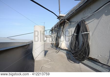 Amplify Tv And Internet System Coaxial Cables And Fiber Optic Cable Hanging In Roll On Residental Ro