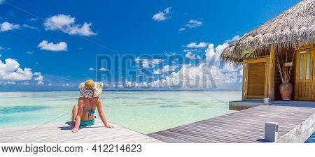 Woman In Bikini And Hat Enjoying Beach Vacation Holidays At Tropical Resort Water Villa With Sea Hor