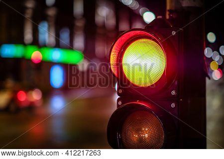 Red Light On Pedestrian Traffic Light In The Street Junction In The City With Beautiful Bokeh Lights