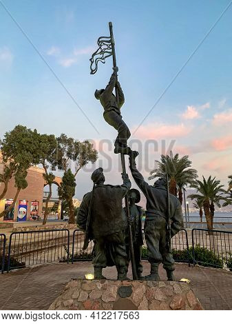 Eilat, Israel - December 03, 2020: Commemorative Sculpture Raising Of The Ink Flag - Group Of Fighte