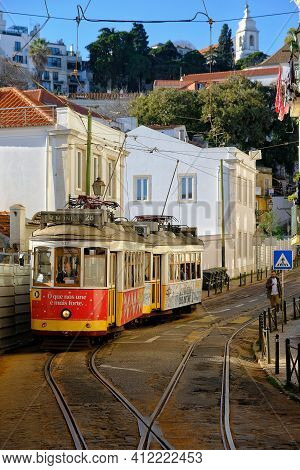 Lisbon,  Portugal - January 4, 2020 : Traditional Tramway In The Picturesque Area Of Alfama In Lisbo