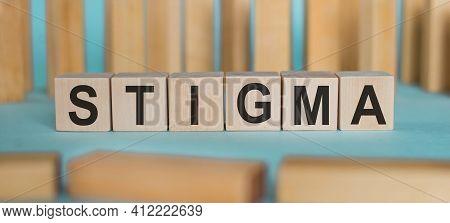 Stigma Word Written On Wooden Blocks On Light Blue Background.