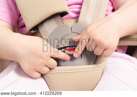 Faceless Small Baby Sitting In Special Car Seat With Safety Seatbelts