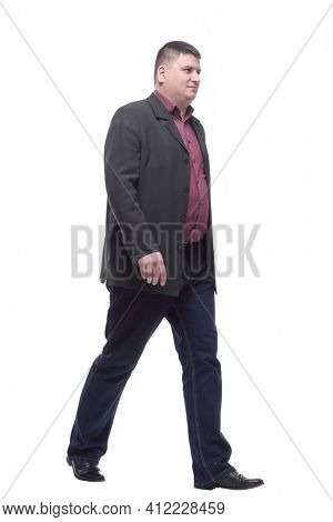 Mature man in business suit striding forward.