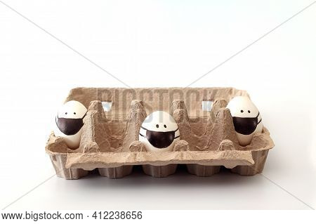 Raw White Eggs In Black Masks In Tray Alternating With Empty Spaces. Concept Of Easter With Social D