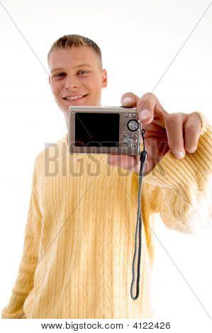 Blonde Man Showing Digital Camera