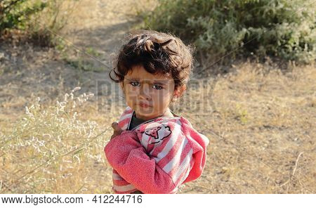 A Small Boy Of Indian Origin Looking At The Camera Angrily. Concept For Today's Children Tomorrow's