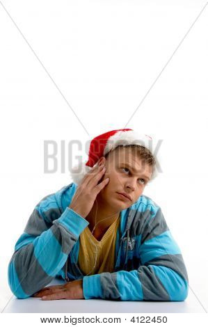 Thinking Man Wearing Christmas Hat