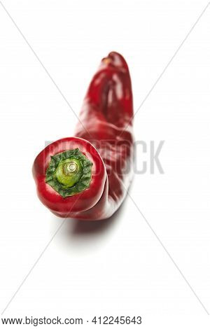 Fresh Natural Ugly Burgundy Pepper Isolated On White Background