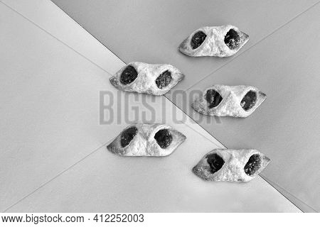 On A Two-color Background, Delicious Puff Pastry Cookies Stuffed With Raspberry Jam. Top View With C