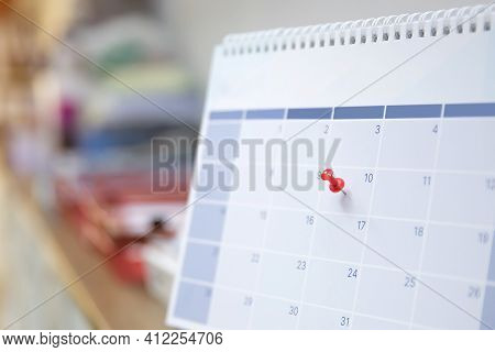 Close-up A Pin On Blank Desk Calendar And Office Equipment Concept Of Events Planner Or Busy Or Plan