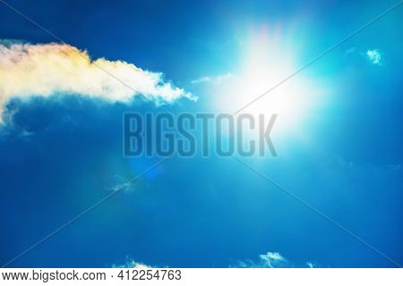 The Sun In The Blue Sky Under The Clouds. Sunny Day. Blue Sky. Bright Midday Sun Illuminates The Spa