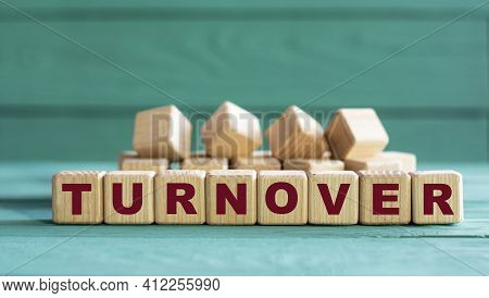 Turnover - Word On Wooden Cubes On A Green Background. Business Concept