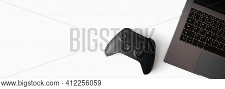 Gamer Gadgets On White Background. Black Wireless Gamepad, And Notebook. Banner. Gamer Flat Lay