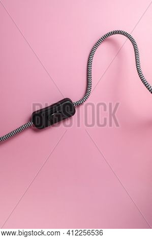 Wire With Black Switch From Table Lamp On Pink Background Flat Lay. Lighting, Lamp, Light, Interior