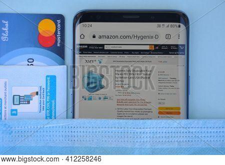 Mandi, Himachal Pradesh, India - 03 04 2021: High Angle Of Buying Medical Mask Online With Mastercar