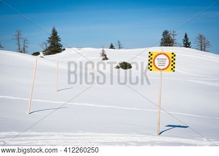 Sign Warning In Multiple Languages Of Closed Skiing Area Due To Avalanche Or Other Danger. Caution A