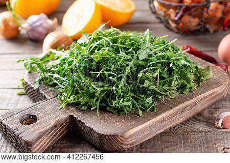 Fresh Arugula On Rustic Wooden Background. Fresh Arugula, Ruccola Leaves, Rucola, Eruca Or Garden Ro
