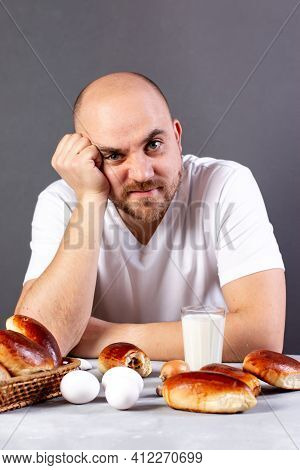 Portrait Of Man With No Appetite In Front Of The Meal. Concept Of Loss Of Appetite.