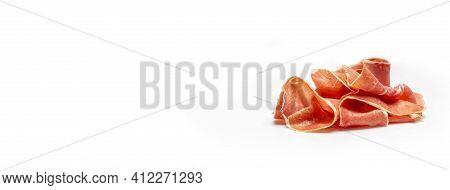 Dry Spanish Ham, Jamon Serrano, Iberian Ham Isolated On White Background. Long Banner Format.