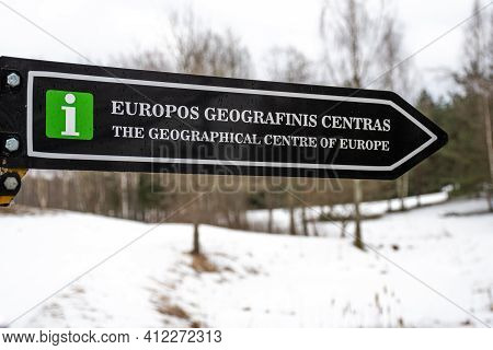 Road Sign Of Geographic Center Of Europe, Vilnius, Lithuania, In Winter With Snow