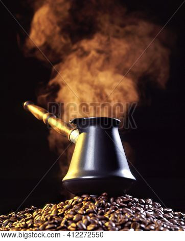 Coffee Jug Standing On A Coffee Beans With Steamy Cloud