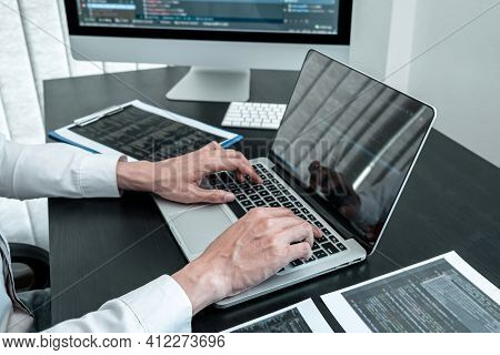 Young Programmer Working In Software Javascript Computer In It Office, Writing Codes And Data Code W