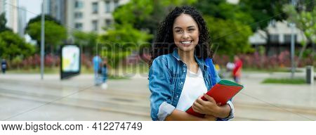 Cute Latin American Young Adult Student With Retainer Outdoor In Summer In City