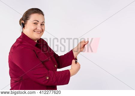 Portrait Of A Chubby Woman With A Flyer And Bluetooth Earphone. Promotions, Discounts, Advertising O