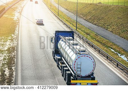 A Big Fuel Tanker Truck . Truck Movement To One Side, Road Junction Along The Autobahn