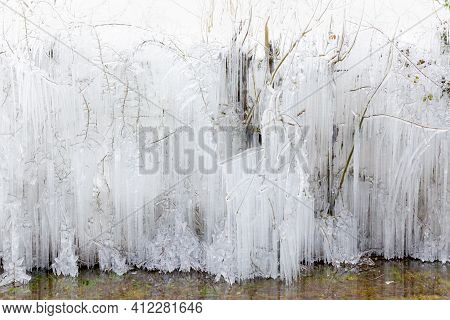 Beautiful Norfolk  Ice And Freezing Icicles Dangling From Large Trees In Winter Near Frozen Water