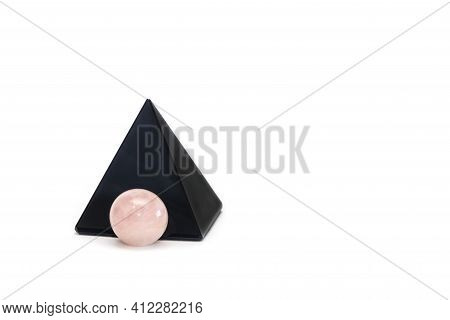 Black Obsidian Pyramid And Rose Quartz Ball. Reiki Concept. Isolated On White Background, Copy Space
