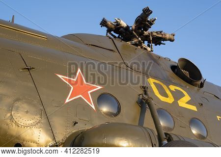 View Of The Red Star On The Hull Of An Old Soviet Helicopter Against The Background Of The Engine An