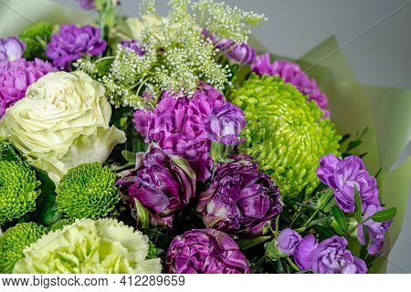 Bouquet Of Pink Roses, Alstroemeria Flowers And Orchids. Fresh Summer Flowers Against Gray Backgroun