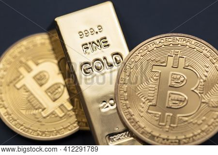 Bitcoin Cryptocurrency Coin With A Gold Bullion Bar. Investment Concept
