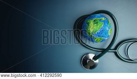 World Health Day. Global Health Awareness Concept. Handmade Globe Inside Stethoscope As Heart Shape.
