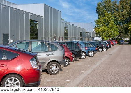 Facade Business Establishment With Row Of Parked Cars