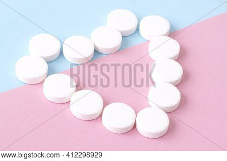A Heart Made Of White Round Pills. The Concept Of Health And Medical Care