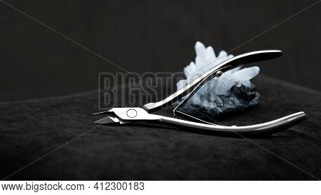 Beautiful Nail Clippers On A Black Background, Nail Clippers