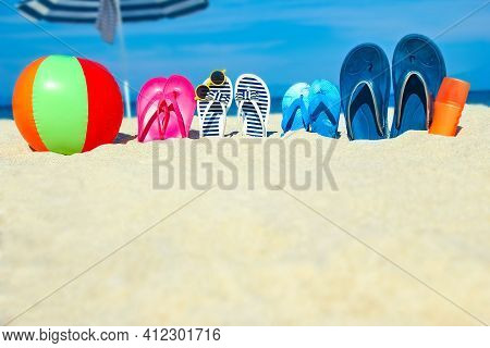 Beach Summer Holiday Banner Background. Flip-flops And Hat With A Board And Ball On The Sand Near Th