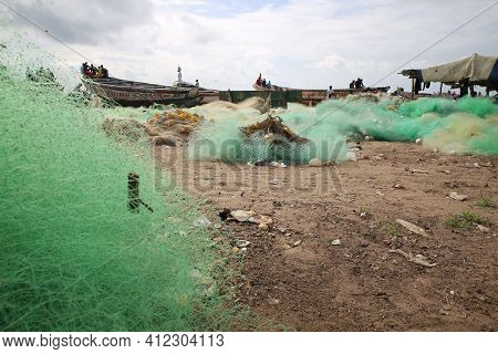 Fishing Nets And African Fishing Boats At The Shore. Fishing Industry In West Africa. Industry And A